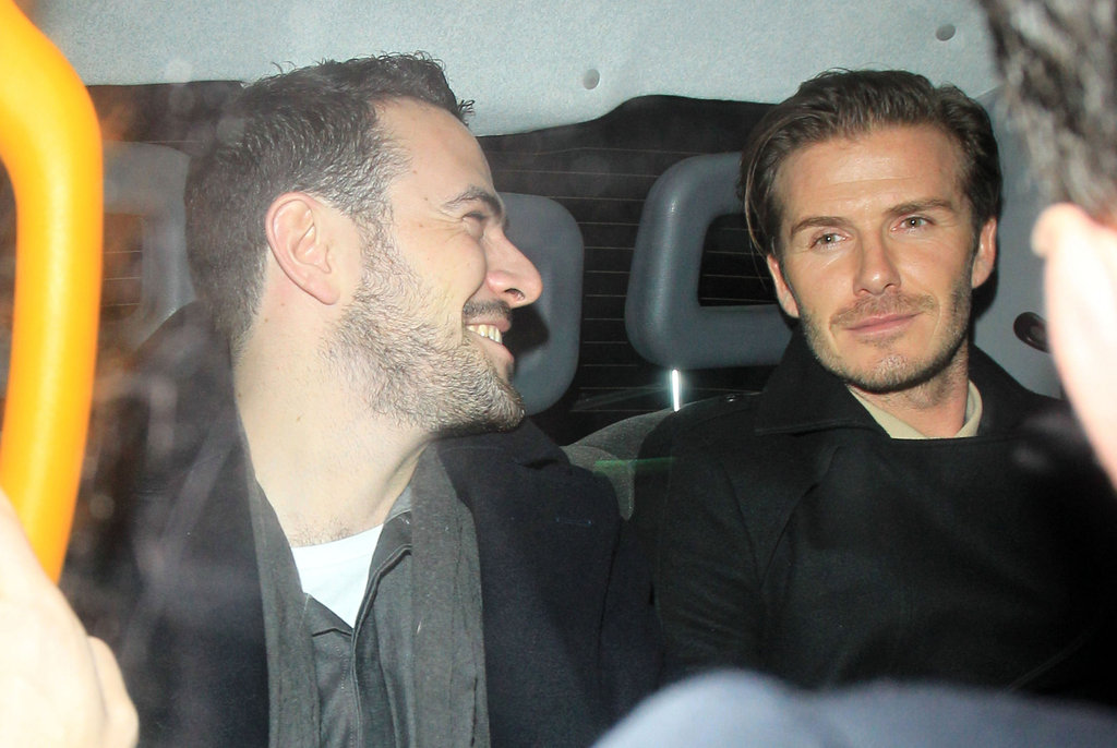 David Beckham left London's Arts Club with a friend.