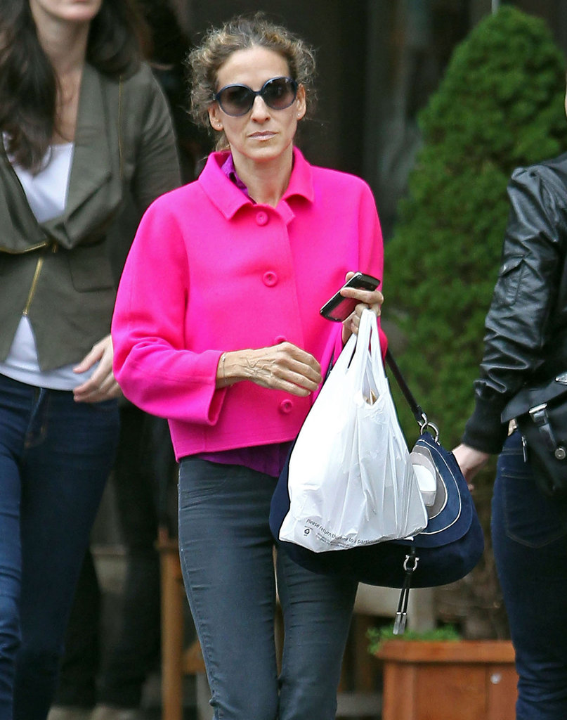 Sarah Jessica Parker's BlackBerry reflects her bright pink coat.