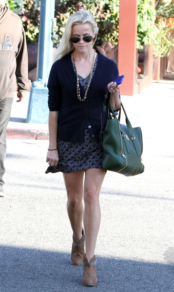 Reese Witherspoon is out and about with her iPhone 4.