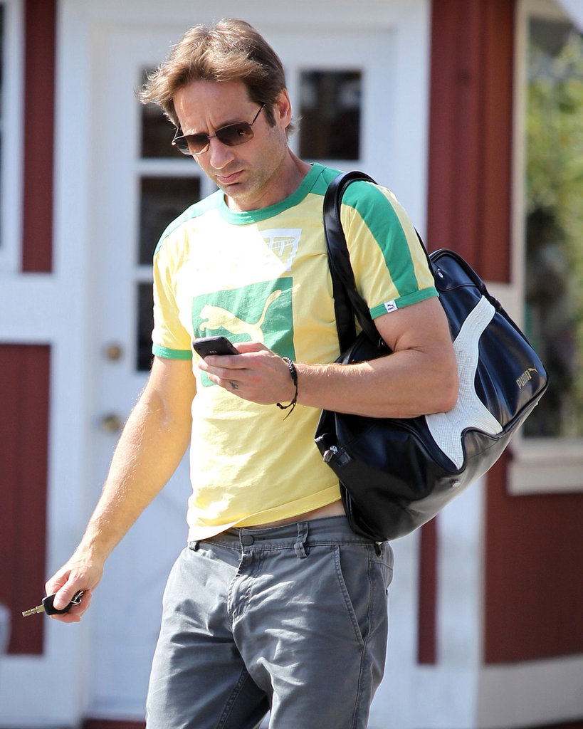 David Duchovny takes a peek at his iPhone after a workout.