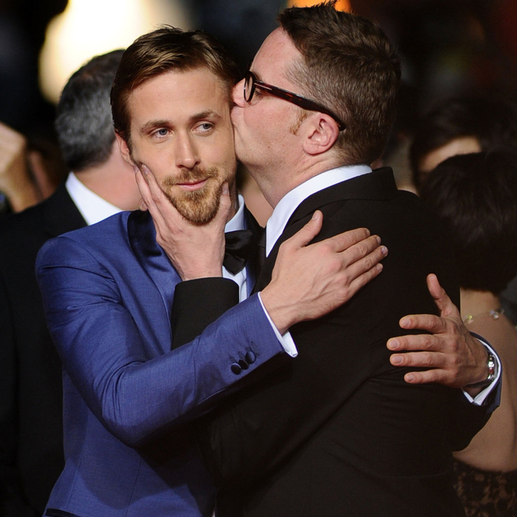 Ryan Gosling gets a kiss from director Nicolas Winding Refn at the Drive premiere in Cannes.
