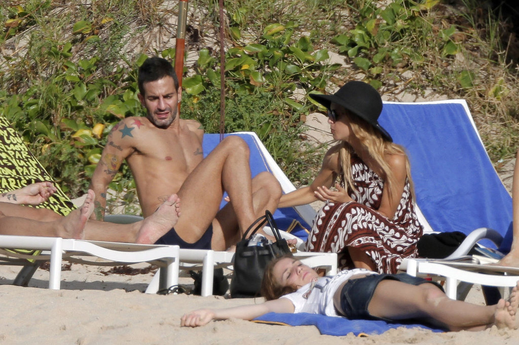 Rachel Zoe covered up in a tribal wrap while Marc Jacobs went shirtless on the beach in St. Barts.