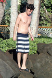 Shirtless Zach Braff navigated some rocks in Maui.
