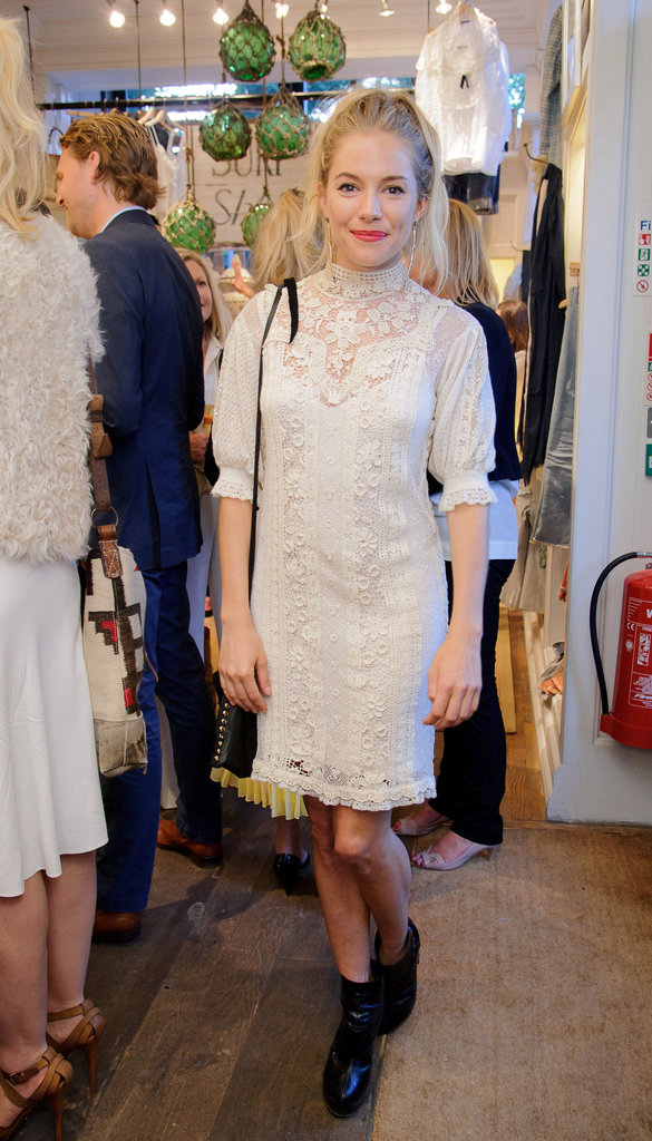 Sienna set off her lacy white dress with a pop of crimson lipstick at Wimbledon in 2011.