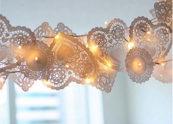 Accent strings of fairy lights with doilies for a fun party accent.