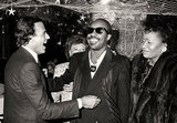 Julio Iglesias and Stevie Wonder joke around at a 1986 New Year's Eve party at Regine's.