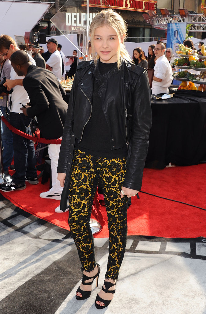 Chloe Moretz's lacy pants offer a femme edge against a tough moto jacket.