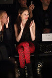 Coco Rocha livened up the front row in a pair of red leopard-print pants.