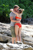 Liam Hemsworth and Miley Cyrus embraced on the beach.