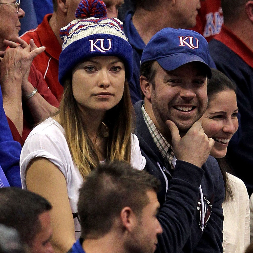 Olivia Wilde focused on the basketball game.