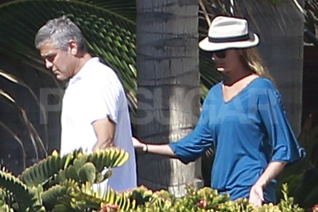 Stacy Keibler held onto George Clooney in Cabo.