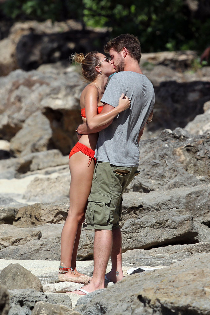 Liam Hemsworth and Miley Cyrus kissed on the sand.