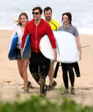 John Krasinski, Emily Blunt, Jimmy Kimmel, and Molly McNearney had a sporty day in Hawaii.
