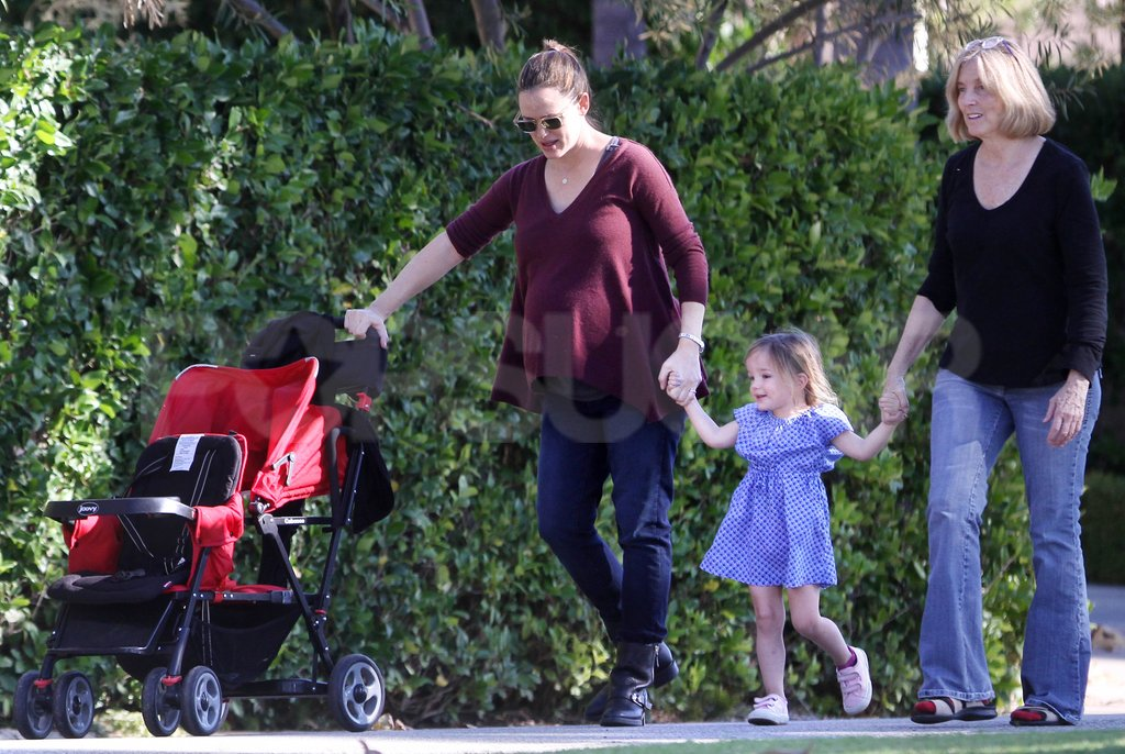 Pat and Jennifer Garner held Serphina's hands.