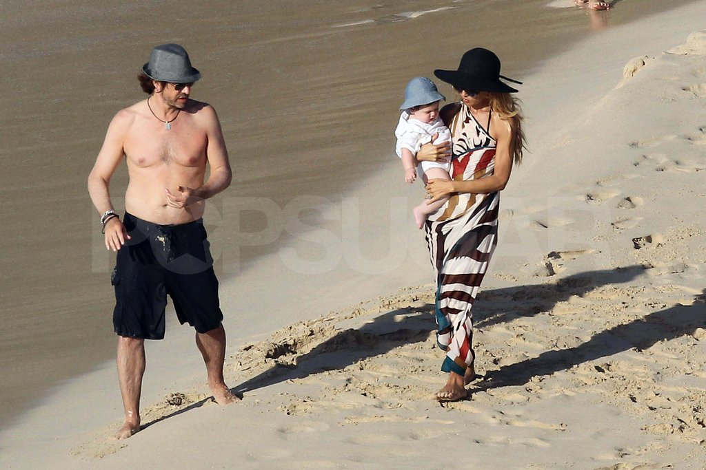 Rodger Berman and Rachel Zoe with Skyler on the beach.