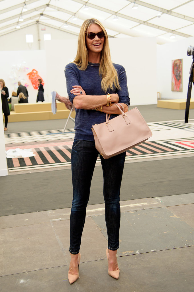 Elle Macpherson lightened up a dark denim look with pointy nude pumps and a matching nude statement handbag.