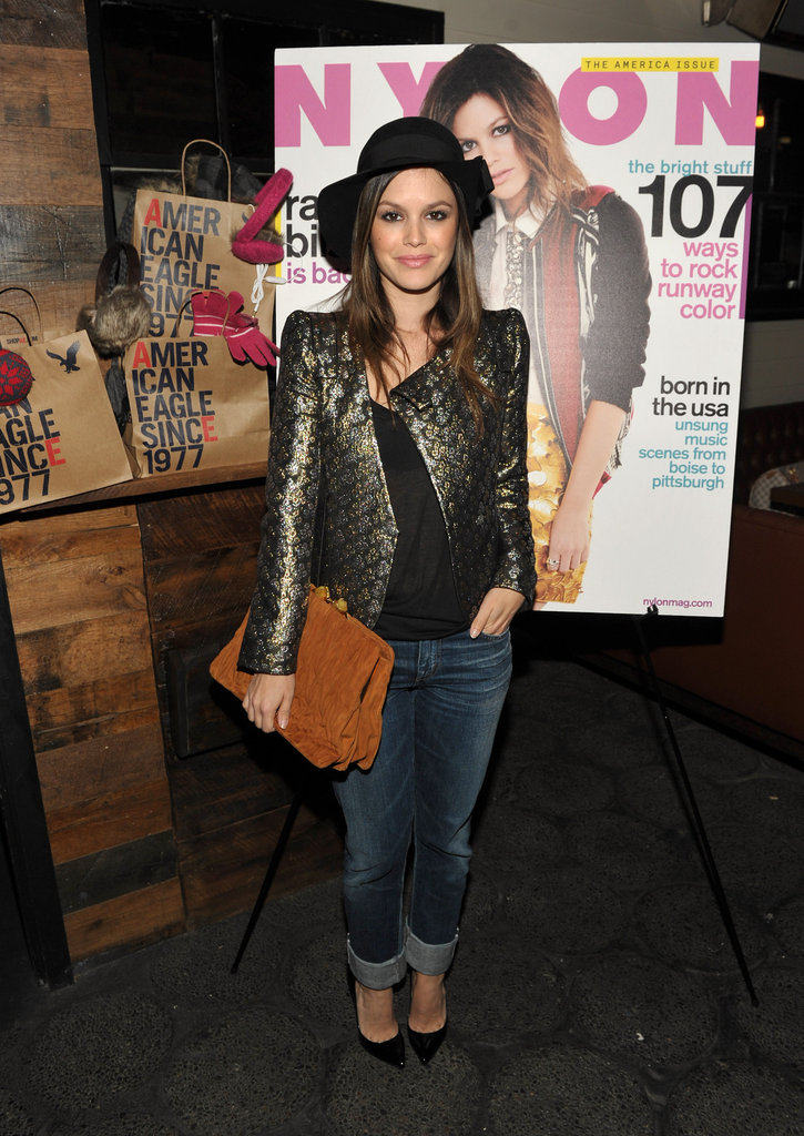 "Rachel Bilson wore a jacquard metallic Vanessa Bruno jacket with GoldSign jeans, an oversized Miu Miu clutch, and Christian Louboutin ""Pigalle"" heels to a Nylon party."