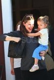Jennifer Garner carrying Seraphina.