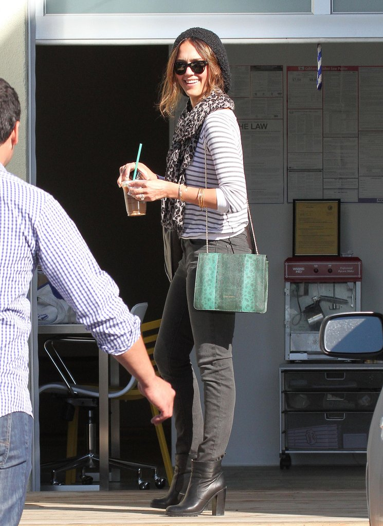 Jessica Alba wore a green crossbody bag for a pop of color.