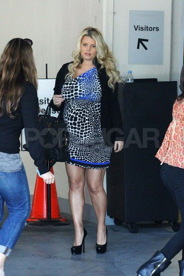 Jessica Simpson pregnant in an animal print dress.