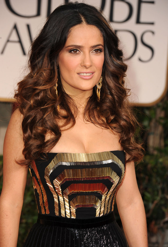 Salma Hayek in a gold and black Gucci dress.