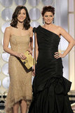 Katharine McPhee and Debra Messing presented at the 2012 Golden Globe Awards.