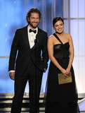 Mila Kunis and Gerard Butler smiled on stage together.
