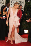 Charlize Theron showed off her long legs in a pink Christian Dior dress.