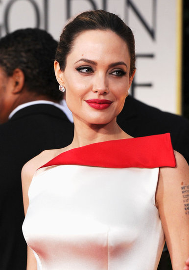 Angelina Jolie was pretty in champagne and red.