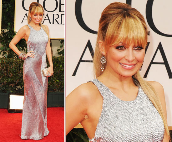 Nicole Richie stepped out tonight in a floor-skimming megawatt metallic Julien Macdonald gown. She paired the slinky silver number with a handful of stacked bangles, an oversized cocktail ring, a small cream House of Harlow 1960 clutch, Jimmy Choo heels, and gorgeous vintage circle-drop earrings.