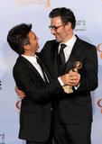 The men behind The Artist, producer Thomas Langmann and director Michel Hazanavicius, celebrate their big night.