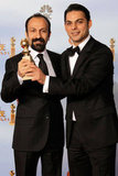A Separation's director Asghar Farhadi and actor-screenwriter Peyman Moaadi celebrate their Golden Globe win.