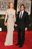 Nicole Kidman and Keith Urban walk hand in hand.
