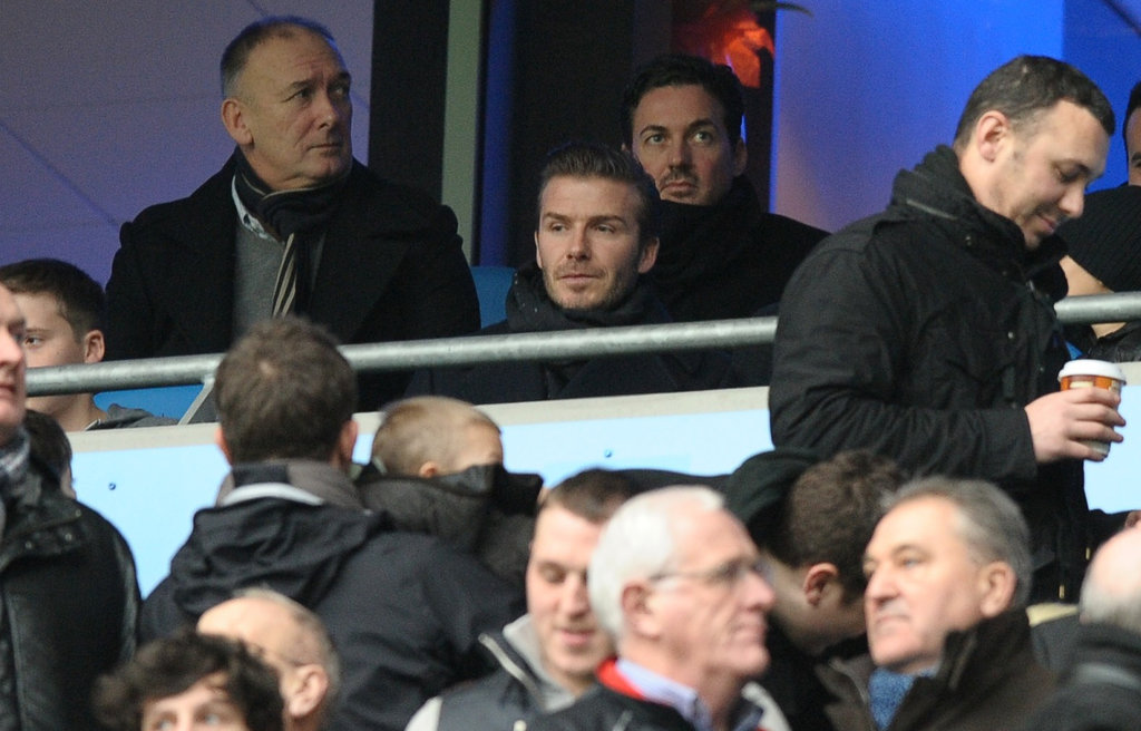 David Beckham dressed in Winter gear for the outdoor match.