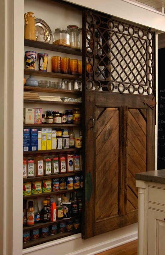 This ornate pantry door works exceptionally well for cramped kitchens — especially if you have an island that takes up a lot of room.    Source