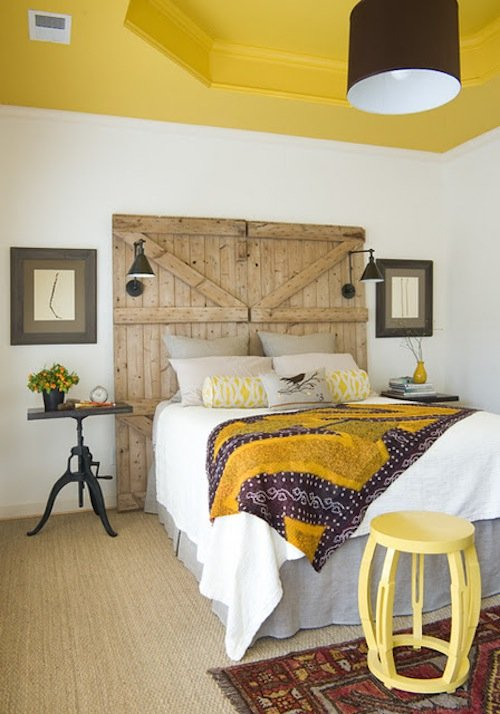 I think that using doors as headboards can be a tricky look to pull off, but the wide frame, natural tones, and industrial sconces help them to feel substantial enough while complementing other elements of the room.   Source