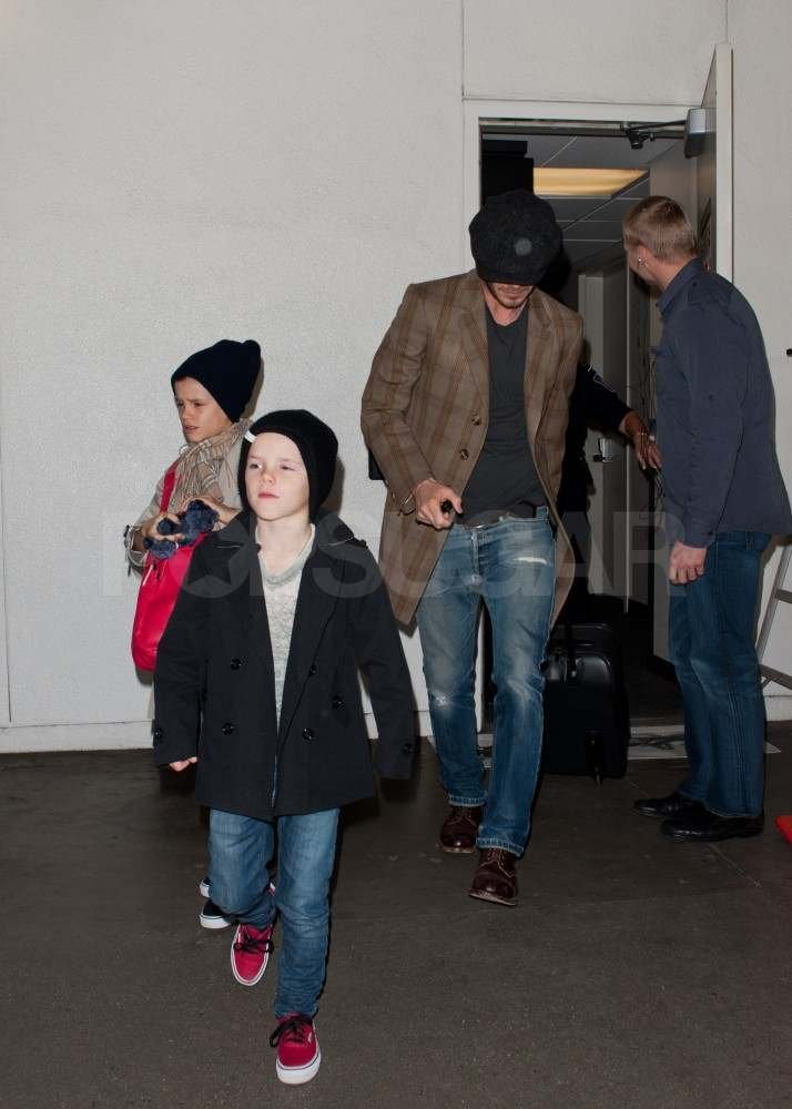 David Beckham with Romeo and Cruz at LAX.
