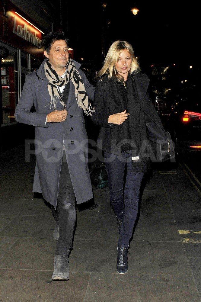 Jamie Hince had his arm on Kate Moss's back.