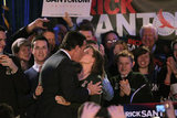 Rick Santorum kisses his wife during a rally in Iowa.