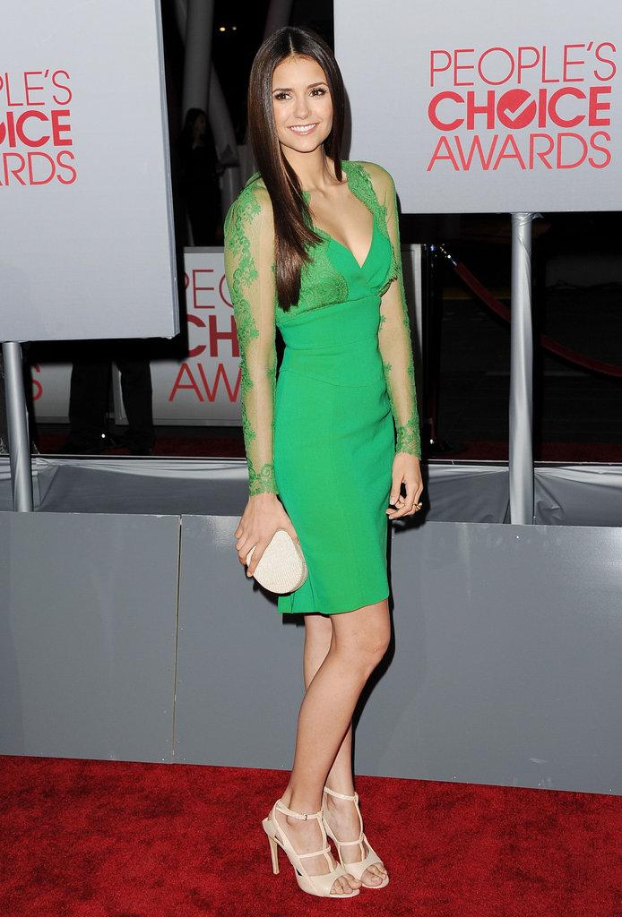 Nina Dobrev in a green Elie Saab dress.