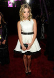 Ashley Benson wearing white on the red carpet.