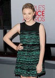 Chloë Moretz in a green minidress.