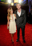 Miley Cyrus took a long look at handsome Liam Hemsworth at the People's Choice Awards.