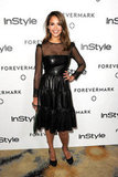 Jessica Alba opted for a sweet-cum-sexy leather and sheer confection.