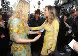 Elle Fanning and Elizabeth Olsen ran into each other at the Critics' Choice Movie Awards.