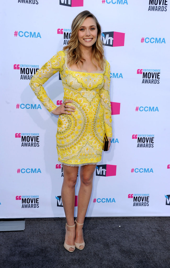 Elizabeth Olsen was all smiles in Emilio Pucci.