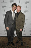 Jesse Tyler Ferguson and Justin Mikita arrived for the Audi and Weinstein Company award season kickoff party.