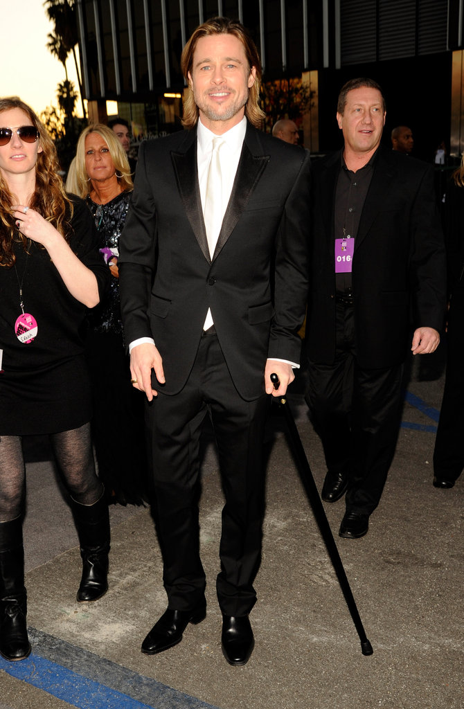 Brad Pitt with a cane at the Critics' Choice Awards.