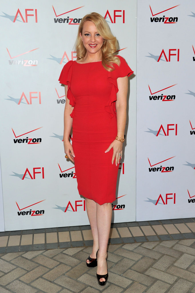 Wendi McLendon-Covey attends the AFI Awards in a red dress.