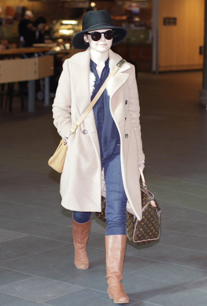 Ginnifer Goodwin styled up her wintry ensemble at the airport — the fedora makes this look a standout.
